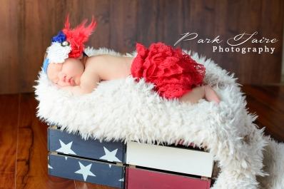 newborn girl red with and blue flag