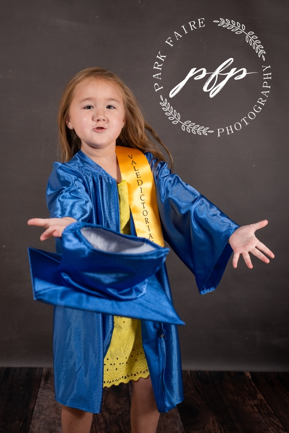 Kindergarten Graduation pose cap throw